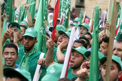 Palestinian supporters of the Islamic Hamas movement attend a rally prior to the Student Council elections at Birzeit University