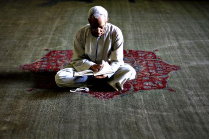 A Muslim man reads the Koran during the holy month of Ramadan in